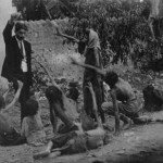 Armenian Genocide Pictures - Turk official teasing Armenian starved children by showing bread